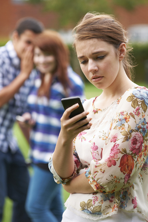 Teenage Girl Victim Of Bullying By Text Message Фото со стока - 49295909