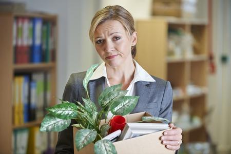 unhappy: Redundant Businesswoman In Office