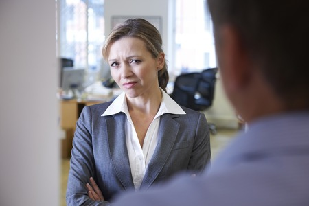 harassing: Businessman Harassing Female Colleague Stock Photo