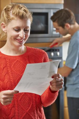 mid thirties: Happy Customer With Repair Bill