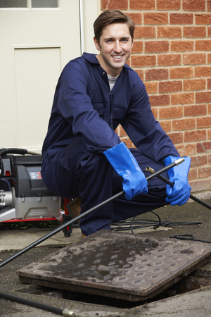 Plumber Fixing Problem With Drains