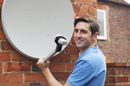 satellite tv: Engineer Installing TV Satellite Dish