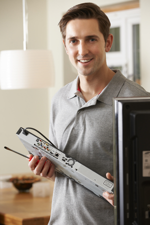 cable tv: Engineer Installing Digital TV Device