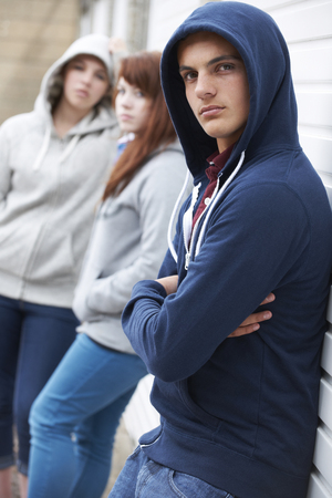 hanging around: Gang Of Teenagers Hanging Around Together Stock Photo