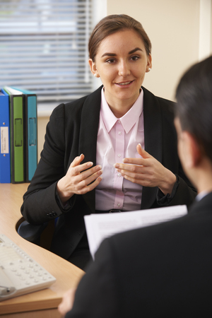 interviewed: Female Job Applicant Being Interviewed Stock Photo