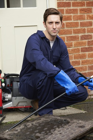 drains: Plumber Fixing Problem With Drains