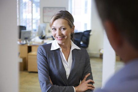 equal opportunity: Businesswoman Being Flirtatious Towards Male Colleague