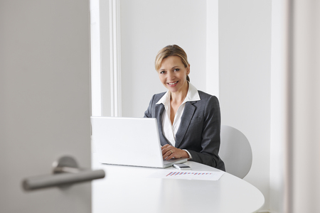 business woman working: Businesswoman Preparing For Meeting In Boardroom
