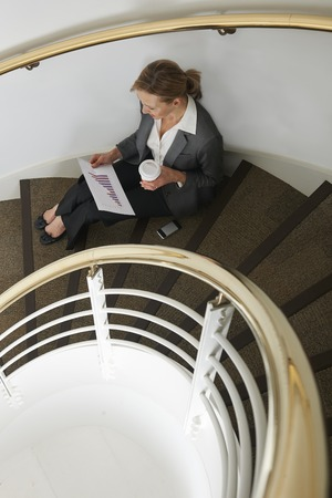 stairwell: Businesswoman Preparing For Meeting In Stairwell Stock Photo