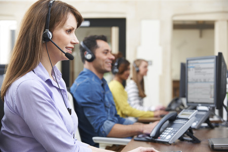 call center office: Female Customer Services Agent In Call Centre