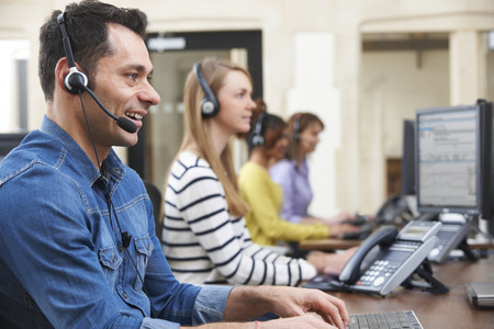 phone call: Male Customer Services Agent In Call Centre
