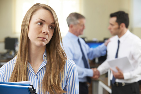 Unhappy Businesswoman With Male Colleague Being Congratulated Reklamní fotografie