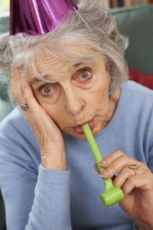 miserable: Senior Woman Not Enjoying Party Celebrations