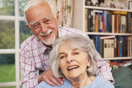 70s adult: Affectionate Senior Couple At Home Together