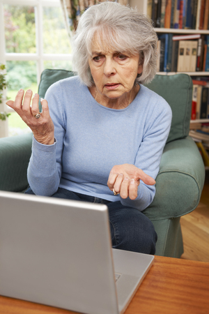 70s adult: Frustrated Senior Woman Using Laptop