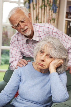 the ageing process: Senior Woman Suffering From Depression Comforted By Husband