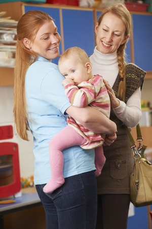 dropping: Mother Dropping Baby At Nursery Stock Photo