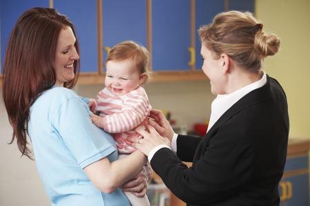Working Mother Dropping Child Off At Nursery Stock Photo