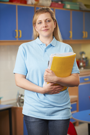 playgroup: Childcare Worker Standing In Nursery