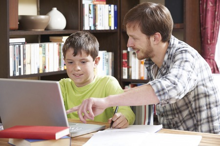 boy 12 year old: Boy Studying With Home Tutor