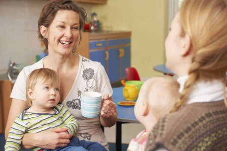 creche: Mothers With Babies Chatting And Drinking Coffee At Playgroup