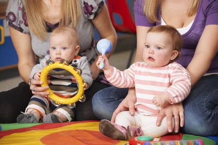 playgroup: Mothers And Babies At Music Group Stock Photo