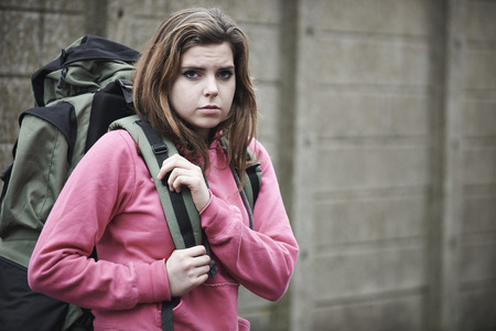 Homeless Teenage Girl On Street With Rucksack
