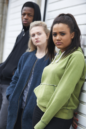boy 18 year old: Group Of Teenagers Hanging Out In Urban Environment Stock Photo