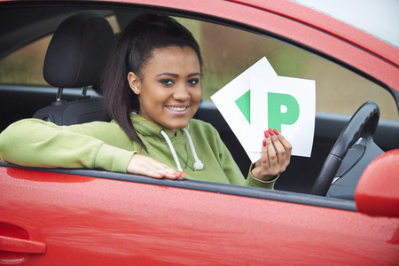 test passed: Teenage Girl Recently Passed Driving Test Holding P Plates