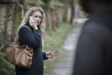 threatened: Teenage Girl Feeling Threatened As She Walks Along Path