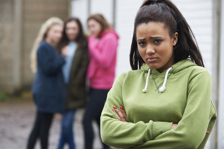 17 year old: Unhappy Teenage Girl Being Talked About By Peers Stock Photo