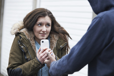 boy 18 year old: Teenage Girl Being Mugged For Mobile Phone Stock Photo