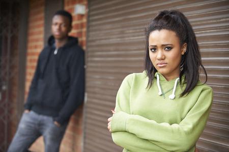 boy 18 year old: Unhappy Teenage Couple In Urban Setting