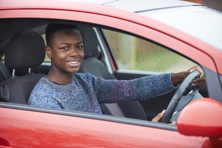boy 18 year old: Newly Qualified Teenage Boy Driver Sitting In Car