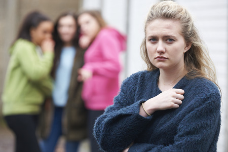 peers: Unhappy Teenage Girl Being Talked About By Peers Stock Photo