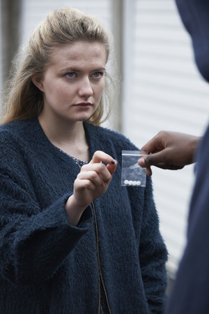 illegal substance: Teenage Girl Buying Drugs On The Street