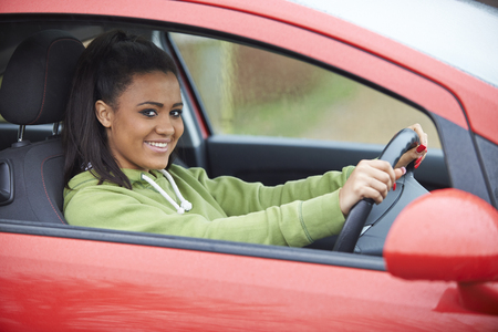 17 year old: Newly Qualified Teenage Girl Driver Sitting In Car Stock Photo