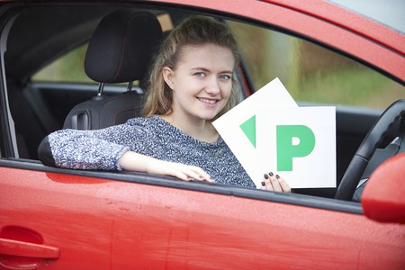 passed test: Teenage Girl Recently Passed Driving Test Holding P Plates
