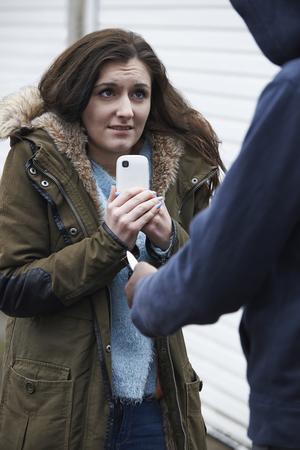 mugged: Teenage Girl Being Mugged For Mobile Phone Stock Photo
