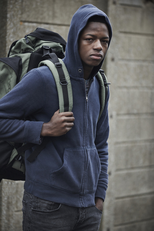 18 year old: Teenage Boy On The Streets With Rucksack Stock Photo