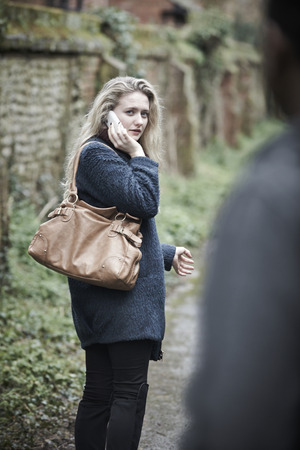 18 year old: Young Woman Feeling Threatened As She Walks Home Stock Photo