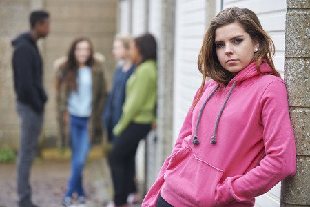 teenage girls: Gang Of Teenagers Hanging Out In Urban Environment Stock Photo