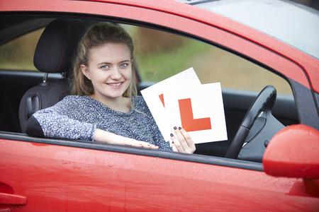 l plate: Teenage Girl Passing Driving Exam Stock Photo
