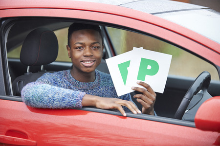 test passed: Teenage Boy Recently Passed Driving Test Holding P Plates