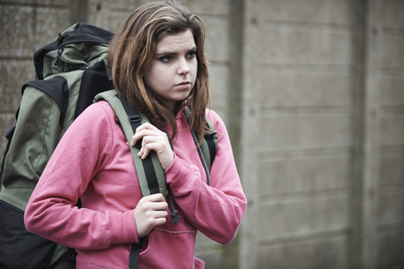 runaway: Homeless Teenage Girl On Streets With Rucksack