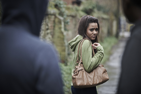 men and women: Teenage Girl Feeling Intimidated As She Walks Home