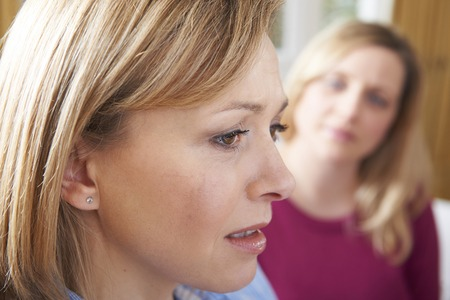 counsellor: Unhappy Woman In Conversation With Friend Or Counsellor