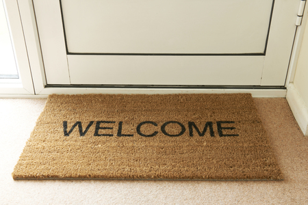 door sign: Welcome Mat Inside Doorway Of Home