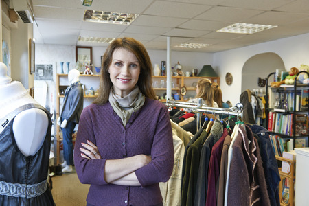 thrift store: Portrait Of Volunteer Working In Charity Shop Stock Photo