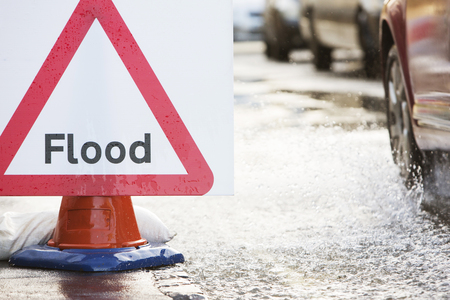 flood water: Warning Traffic Sign On Flooded Road With Cars